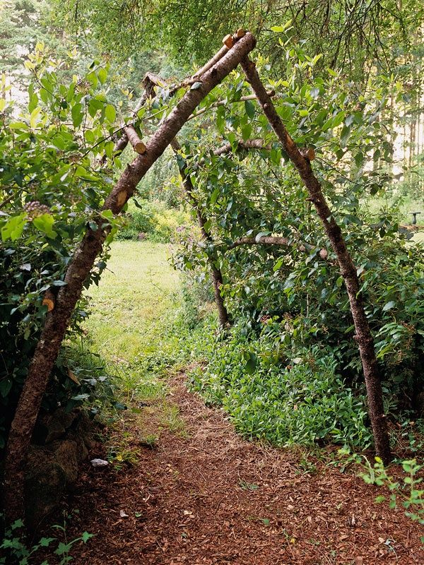 rustic garden arbor out of sticks.
